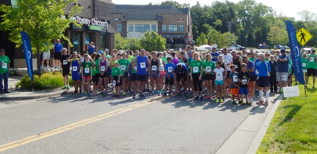 photos of runners about to start a community race