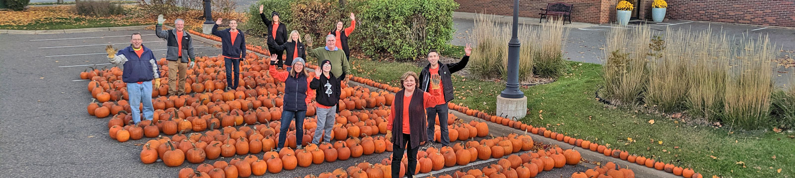 image of a group of Gateway Bank associates waving at the annual fall festival